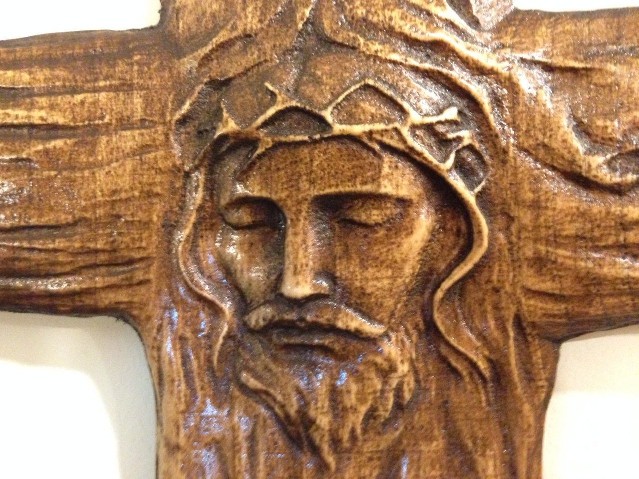 Wooden carved cross bares the image of jesus christ aj